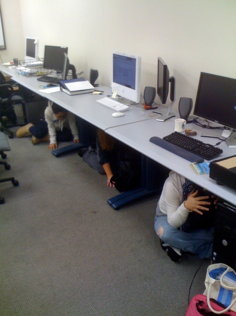 UCLA Instructional Technology Consultants (ITCs) demonstrating how to properly 'duck and cover' during the Great California Shakeout on October 15, 2009.