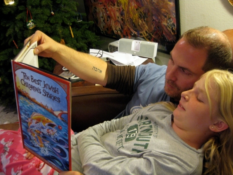 Dr. Robert R. Cargill reads to his daughter, Talitha.