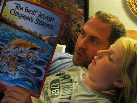 Dr. Robert R. Cargill reading to his daughter, Talitha.