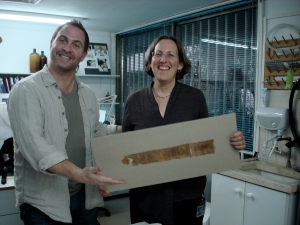 Robert Cargill and Pnina Shor view a mounted Dead Sea Scrolls being prepared for exhibition in the Israel Antiquities Authority's Artifacts Treatment and Conservation lab in Jerusalem.