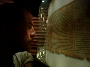Dr. Robert Cargill viewing the copy of the Great Isaiah Scroll at the Shrine of the Book in Jerusalem's Israel Museum.