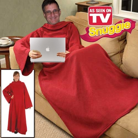 "Dr. Jim West debunks the myth that scholars ""curl up by the fire with their leather bound books."" Here, Dr. West curls up on the couch in his Snuggie and laptop."